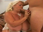 Long Haired Full Figured Mature Blonde Whore Linda With Unreal Gigantic Gazongas And Pierced Nipples Gets Naked While Teasing Tall Handsome Jay And Sucks His Cock With Great Lust.